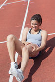 Runner suffering from leg cramp — Stock Photo
