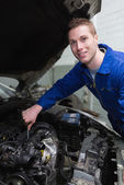 Young mechanic repairing car engine — Stock Photo