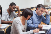 Students taking lecture notes — Stock Photo