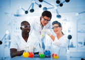 Group of chemist examining test tubes — Stock Photo