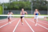 Athletes running towards finish line — Stock Photo