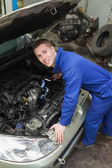 Mechanic examining car engine — Stock Photo