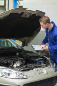 Mechanic checking car engine — Stock Photo