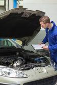 Mechanic checking car engine — Stock Photo
