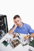 Portrait of tired computer engineer with cpu parts — Stock Photo