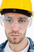 Close-up of architect wearing protective eyewear and hardhat — Stock Photo