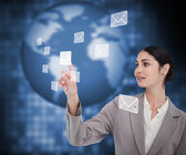 Brunette businesswoman pressing envelope on touch screen — Stock Photo