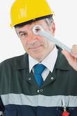 Mature repairman holding wrench — Stock Photo