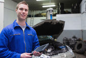 Male mechanic with digital tablet at garage — Stock Photo