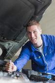 Auto mechanic working on motor — Stock Photo