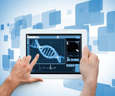 Hand holding a medical digital tablet — Stock Photo