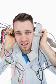 Close-up portrait of it professional yelling with cables in hand — Stock Photo