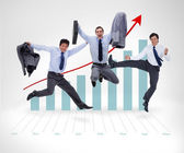 Businessmen jumping before graphical presentation — Stock Photo