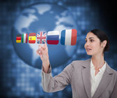 Businesswoman choosing flag of Great Britain — Stock Photo