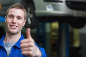 Smart car mechanic gesturing thumbs up — Stock Photo