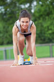 Female athlete at starting blocks — Stock Photo