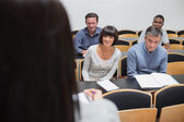 Students looking at lecturer — Stock Photo
