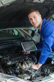 Happy mechanic with digital tablet — Stock Photo