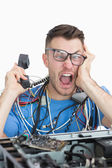 Frustrated computer engineer screaming while on call in front of — Stock Photo