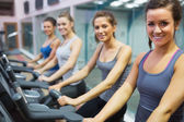 Smiling women at spinning class — Stock Photo