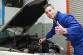 Mechanic gesturing thumbs up — Stok fotoğraf
