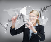 Businesswoman using graphical presentation on touch screen — Stock Photo