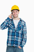Portrait of young male architect using cellphone — Stock Photo