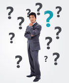 Businessman thinking on question mark background — Stock Photo