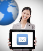 Businesswoman showing digital tablet showing mail symbol — Stock Photo