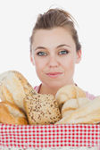 Young woman with variety of breads — Stock Photo