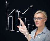 Businesswoman using graphical presentation — Stock Photo