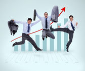 Businessmen jumping against a graphical presentation — Stock Photo