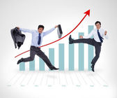 Two businessmen jumping against a background — Stock Photo