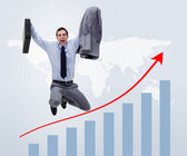 Businessman jumping above graphical presentation — Stock Photo