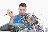 Confused it professional with screw driver and cables in front o — Stock Photo