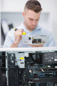 Computer engineer working on cpu part in front of open cpu — Stock Photo