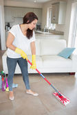 Woman mopping the living room floor — Стоковое фото