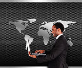 Businessman standing against a picture with part of globe — Stock Photo