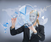 Businesswoman working with graphs on touch screen — Stock Photo