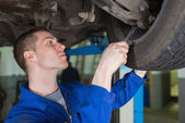 Auto mechanic repairing car with spanner — Stock Photo
