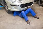 Mechanic under car — Stock Photo