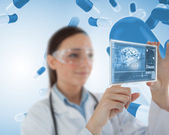 Smiling laboratory worker using virtual screen — Stock Photo