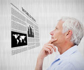 Man reading world news hologram — Stock Photo