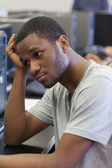 Student looking upset in computer room — Stock Photo
