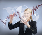 Businesswoman touching graphs — Stock Photo