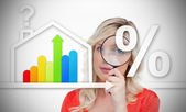 Woman standing behind energy efficient house graphic with questi — Stock Photo