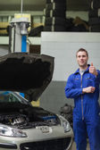 Mechanic by car gesturing thumbs up — Stock Photo