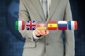 Businessman activating German flag on touchscreen — Stock Photo