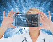 Woman holding a virtual screen — Stock Photo
