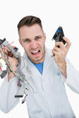 Portrait of young it professional yelling with cpu parts in hand — Stock Photo